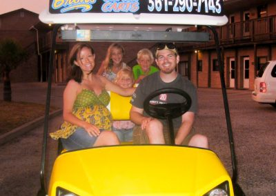 Gallery - Family in Yellow Cart